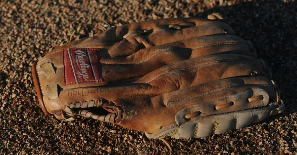 Worn out Rawlings baseball glove